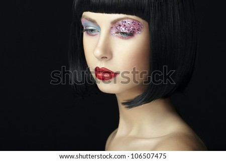 Fashion photo of young woman with dark hair. Woman in black wig
