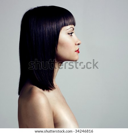 Fashion photo. Profile of woman with strict hairstyle - stock photo