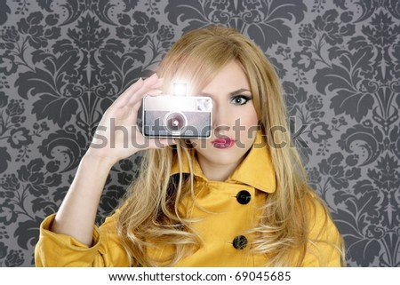 fashion photographer retro camera reporter woman vintage wallpaper yellow coat [Photo Illustration] - stock photo