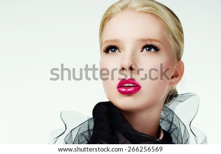 Fashion photography of a beautiful blonde model with pink lips