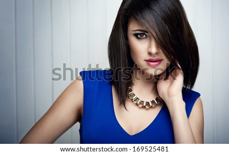 fashion picture of beautiful brunette woman with necklace - stock photo