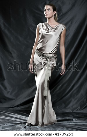 Fashion pictures of a beautiful woman wearing cream satin cocktail dress