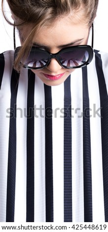 Fashion portrait. Brunette in sunglasses and striped dress isolated. Beauty and fashion. - stock photo