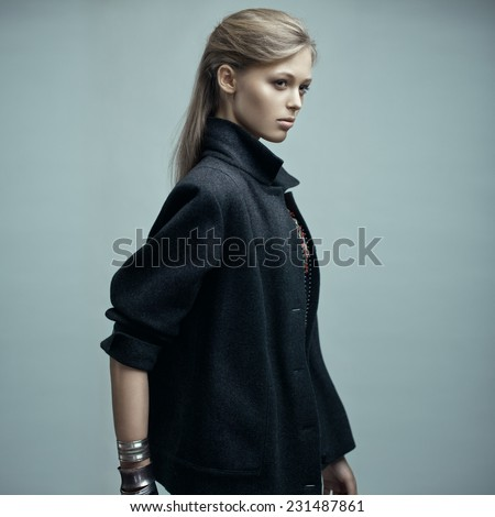 Fashion portrait of a beautiful blonde model with long straight hair. - stock photo