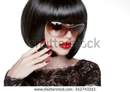 Fashion portrait of a beautiful brunette woman with shot hairstyle with red sunglasses. Red lips. Manicured nails.Isolated on white background. Studio photo - stock photo