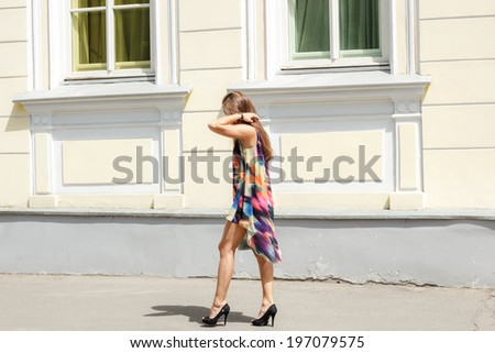 Fashion portrait of a beautiful woman on urban background