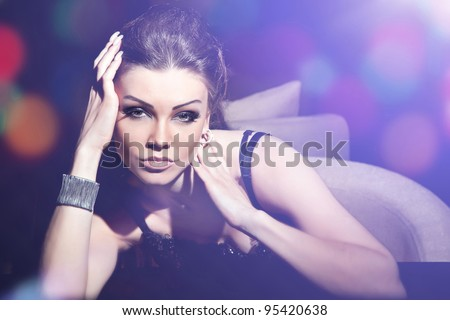 Fashion portrait of a beautiful woman with make-up - stock photo