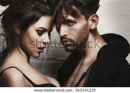 Fashion portrait of a beautiful young couple - stock photo