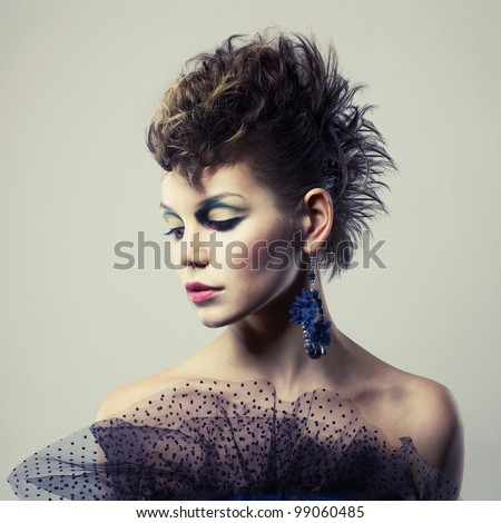Fashion portrait of a beautiful young lady of punk - stock photo