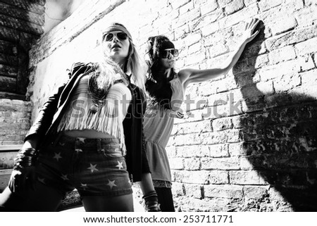 Fashion portrait of a beautiful young sexy womans wearing sunglasses - stock photo