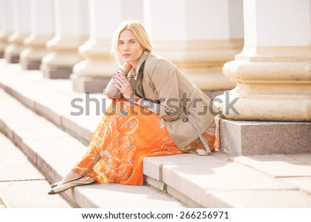 fashion portrait of a beautiful young woman on city background - stock photo