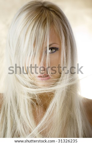 fashion portrait of a cute blond girl with long hair on yellow background - stock photo