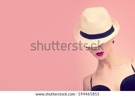 Fashion portrait of a girl in retro style - stock photo