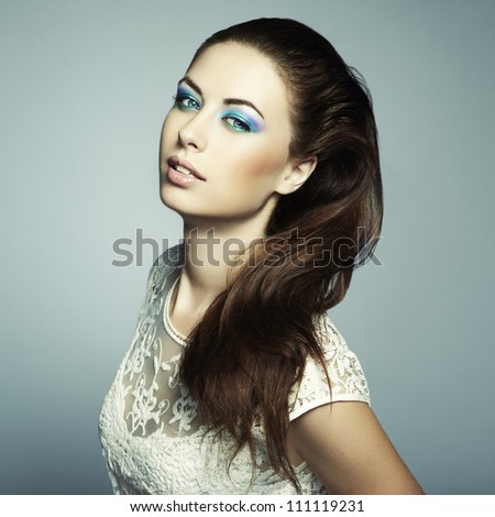 Fashion portrait of a happy young woman smiling. Fashion photo - stock photo