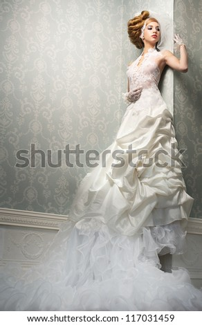 Fashion portrait of a sexy tall bride in white wedding dress - stock photo
