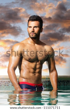 Fashion portrait of a very muscular sexy man - stock photo