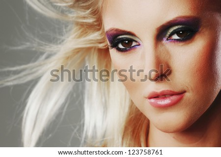 fashion portrait of a woman on a gray background - stock photo