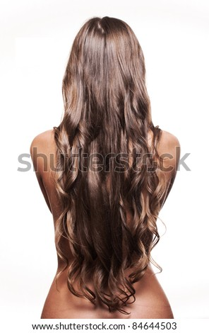 fashion portrait of a woman with long and curly hair - stock photo