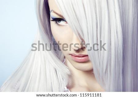 Fashion portrait of a young beautiful blonde woman. Winter Makeup - stock photo