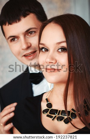 Fashion portrait of a young beautiful couple. Stylish and elegant. Small amount of grain added for best final impression. - stock photo