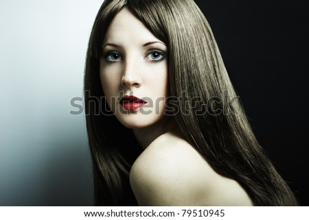 Fashion portrait of a young beautiful dark-haired woman - stock photo