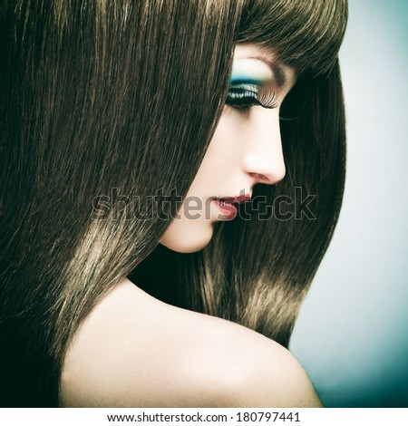 Fashion portrait of a young beautiful dark-haired woman. Fashion photo - stock photo