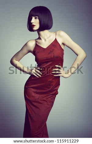 Fashion portrait of a young beautiful dark-haired woman. Studio photo - stock photo