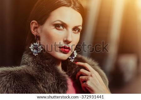 Fashion portrait of a young beautiful woman - stock photo