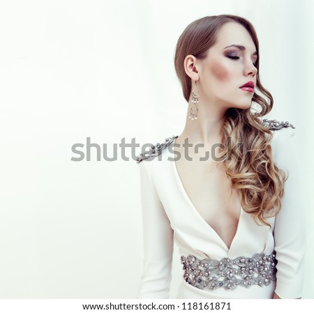 fashion portrait of a young girl in a white dress - stock photo
