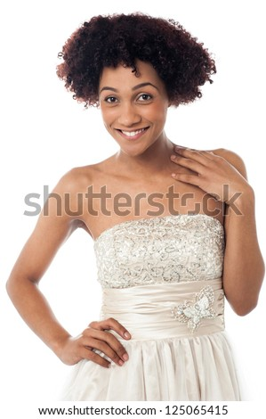 Fashion portrait of a young glamorous female model in white corset.
