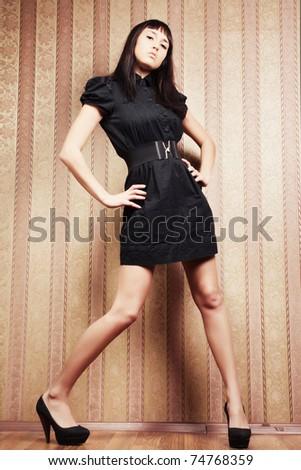 fashion portrait of a young sexy woman in the retro interior - stock photo