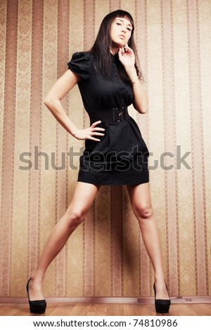 fashion portrait of a young sexy woman in the retro interior - stock photo