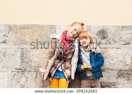 Fashion portrait of adorable kids outdoors - stock photo