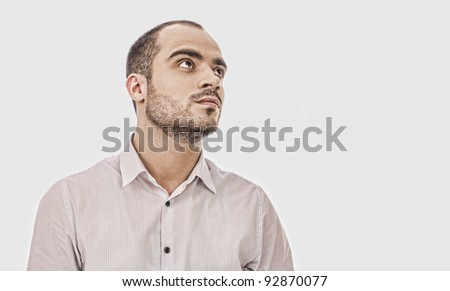 Fashion portrait of adult handsome business man looking away - stock photo