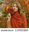 Fashion portrait of amazing woman with autumn scenery - stock photo