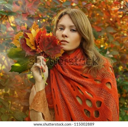 Fashion portrait of amazing woman with autumn scenery - stock photo