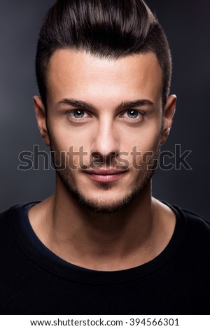 Fashion portrait of an attractive young man in the studio, close up. Beauty concept. - stock photo