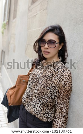 Fashion Portrait of Asian Lady Along the Street in Downtown  - stock photo