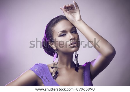 Fashion portrait of beautiful african woman in ethnic earrings - stock photo