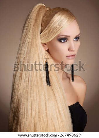 fashion portrait of beautiful blond young woman. girl with Long healthy hair - stock photo