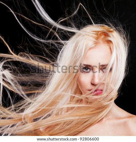 Fashion Portrait of beautiful blonde with the flying hair