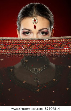 Fashion portrait of beautiful female wearing traditional indian costume - stock photo