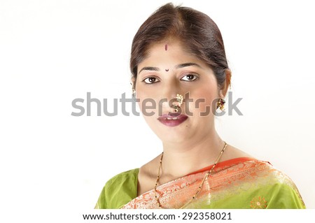 Fashion portrait of beautiful female wearing traditional indian costume, over white background - stock photo