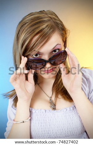 Fashion portrait of beautiful girl in sun glasses