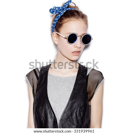 Fashion portrait of beautiful girl wearing sunglasses. Close-up of cute woman on white background not isolated - stock photo