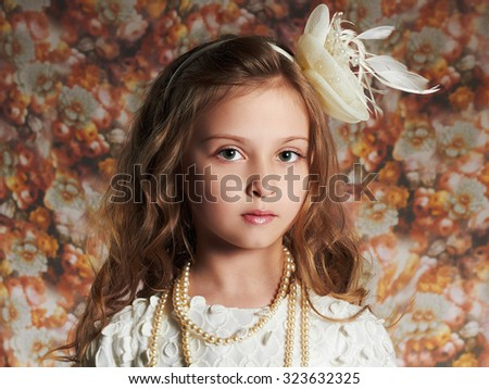 fashion portrait of beautiful little girl. floral background.funny child - stock photo