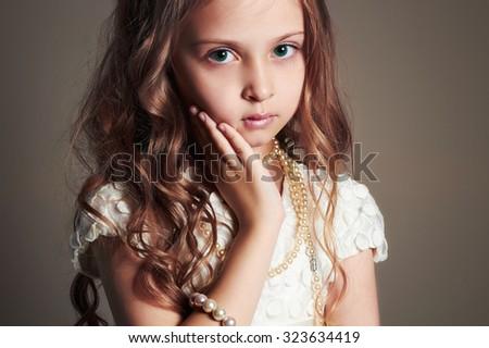 fashion portrait of beautiful little girl.pretty little lady - stock photo