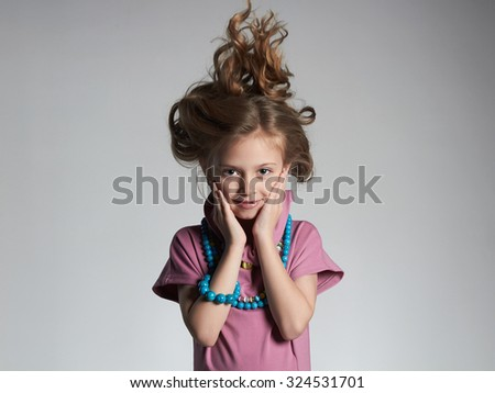 fashion portrait of beautiful little girl with healthy hair.pretty little lady in dress and accessories - stock photo
