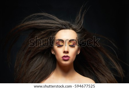 fashion portrait of beautiful make-up woman with flying hair.beauty make up girl.colorful eye shadow