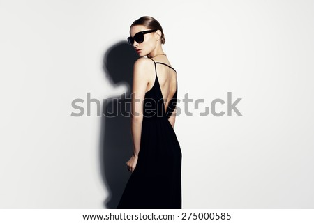 fashion portrait of beautiful model with sunglasses